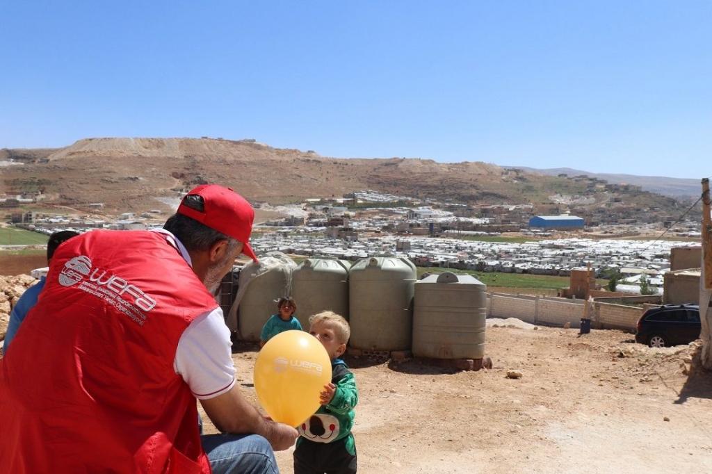 Ramazan yardımları kapsamında Lübnan'da bulunan WEFA Uluslararası İnsani Yardım Organizasyonu Suriyeli mültecilerin yoğunlukta yaşadığı Arsal Kampı'nda zekât ve kumanya yardımında bulundu.